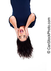 upside down photo of beautiful young woman looking surprised