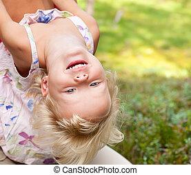 Upside down - Portrait of cute little girl enjoying a summer...
