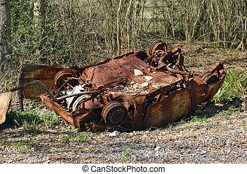 Upside down rusting car