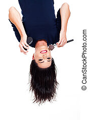 upside down view of woman doing makeup
