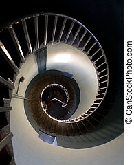 Upside view into the spiral of a lighthouse
