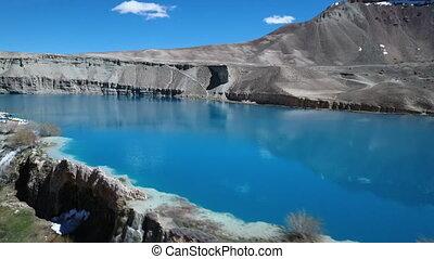 Upward areal tilt of blue lake basin. - Band-e Amir Lakes....