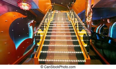 Upward motion by stairs to second level of theater - Upward...