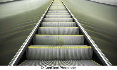 Upward movement standing on an empty escalator, full HD,...