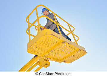 Upward view of man in cherry picker