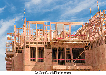 Upward view of multistory apartment building with patio under construction near Dallas, Texas