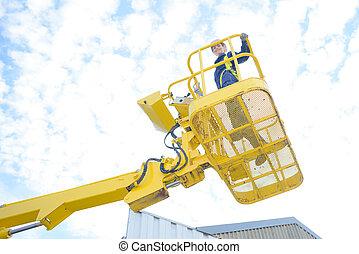 Upward view of woman in cherry picker bucket