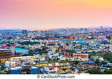 Urasoe, Okinawa, Japan town skyline at twilight.