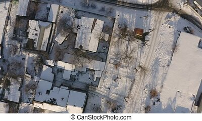Urban aerial view of Dnipro city rooftops patio. Winter...