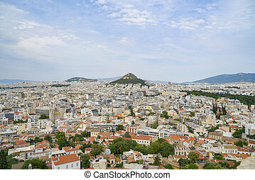 Urban Athens spreading out below with landmark Mount Lycabettus in centre of image