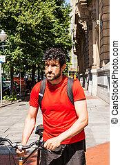 Urban athlete walking with a bike - Urban athlete walking...
