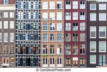 Urban background with residential building windows in Amsterdam