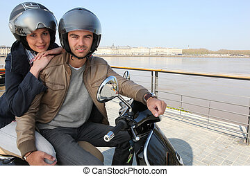 Urban couple on a scooter