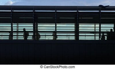 Urban crowd on an overpass - People rushing at a station,...