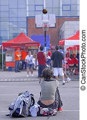 Urban culture - Teen girl watching to boys playing street...