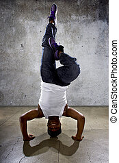 Urban Dancer Doing a Headstand or Yoga - Inverted black...