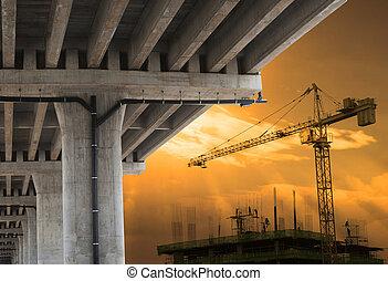 urban development by big crane building construction with beautiful sky in evening scene