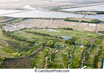 urban development - new development and golf course on...