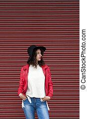 urban fashion girl on red background
