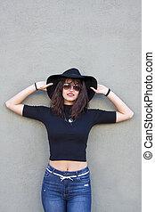 urban fashion girl on the wall