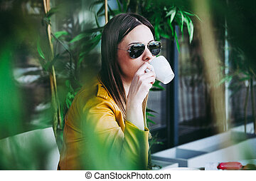 urban girl sit in cafe drinking coffee outdoor