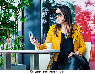 urban girl sit in cafe outdoor city life concept