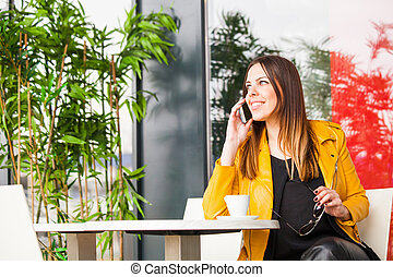 urban girl sit in cafe talk on smartphone city life concept
