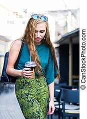Urban girl with coffee on the street