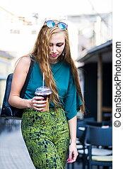 Urban girl with coffee on the street