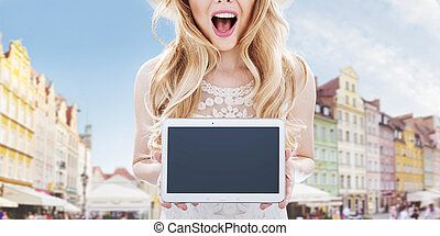 Urban ladnscape - pretty woman holding a tablet