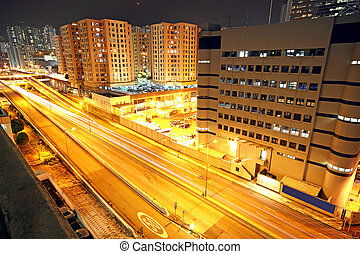 urban landscape at night and through the city traffic