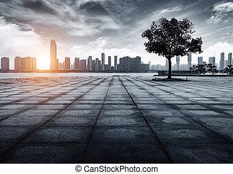 Urban Landscape - Riverside cityscape, clouds and sunshine...