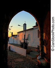 Urban landscape to the together twilight to the door of medieval castle. Portel, Portugal