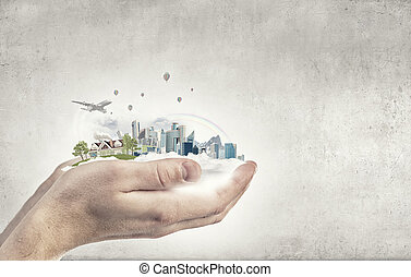 Urban life - Close up of hands holding image of modern ...