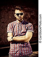 urban life - Fashionable handsome young man posing outdoor. ...