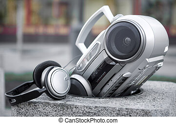 Urban life - Mp3 stereo system with headphones in the stone ...