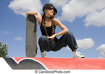 Urban life - Portrait of a young women holding a skate