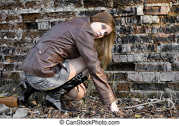Urban life - Pretty girl on the brick wall background