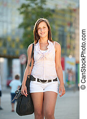 Urban lyfe - cute girl with a bag on a street