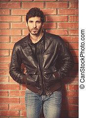 urban man - Portrait of a handsome brunet man in black...