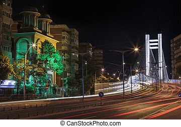 Urban night view with tramway and Basarab Bridge