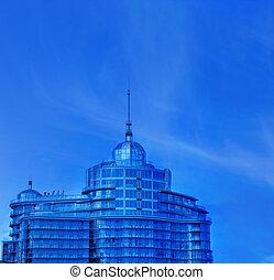 Urban office building over blue sky