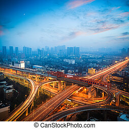 urban overpass at dusk, city traffic background