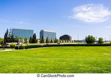 Urban park in Silicon Valley; city skyline in the background; Santa Clara, south San Francisco bay area, California