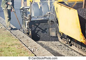 urban road asphalting works - asphalt paver machine during ...