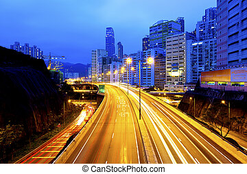 Urban road with light trails in Hong Kong