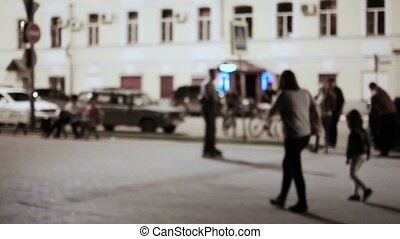 Urban scene mom and doughter walking in the night street slow motion vintage color