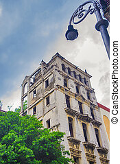 Urban scene with crumbling colonial building in Old Havana, Cuba