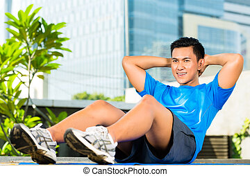 Urban sports - fitness in Asian or Indonesian city - Urban...
