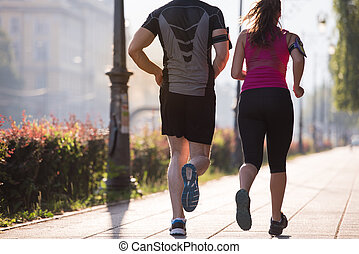 young couple jogging  in the city
